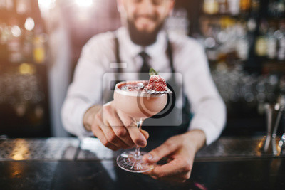 Sticker Professional bartender is making cocktail at night club