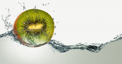 Sticker Ripe fruit of kiwi and sparks of water.