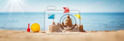 Sticker Sandcastle sur la mer en été