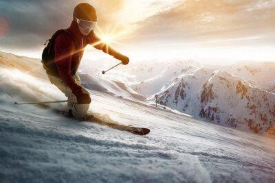 Sticker Skier dans un cadre de coucher de soleil