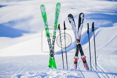 Sticker Skis in snow in winter season, mountains and ski items or equipments on the top in dolomites,