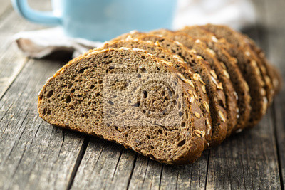 Sticker Sliced whole grain bread with oat flakes. Wholemeal bread.