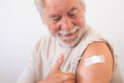 Sticker Smiling senior man 70s after receiving the coronavirus covid-19 vaccine.