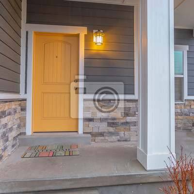 Sticker Square Entryway of a home with stairs going up to the front porch and door