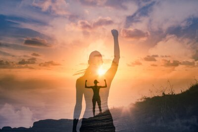 Sticker Strong confident woman on mountain top flexing arms facing the sunset. People feeling inspire, and finding inner strength concept. double exposure.