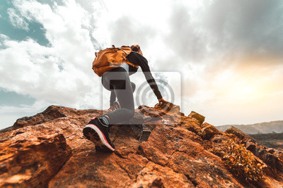 Sticker Success woman hiker hiking on sunrise mountain peak - Young woman with backpack rise to the mountain top. Discovery Travel Destination Concept