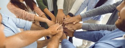 Sticker Team of business people who work together joining hands. Teamwork themed banner background with group of colleagues standing in circle and stacking hands. Concept of union, teamwork and partnership