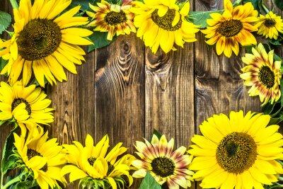 Sticker Tournesols sur fond de bois rustique. Fleurs de fond.