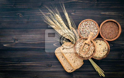 Sticker Various natural organic cereal and whole grains seed in wooden bowl for healthy food ingredient product concept.