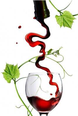 Sticker Verser le vin rouge dans un verre avec tige isolé sur blanc