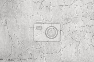 Vieux blanc patiné mur de béton de texture avec des fissures