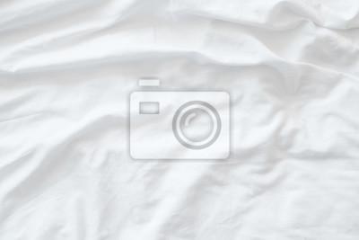 Sticker Vue de dessus des draps de literie non façonnés ou du fond blanc de la texture des rides