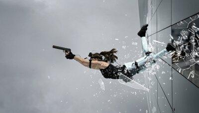 Sticker Woman playing on the simulator, holding gun.   Blockbuster, action movie