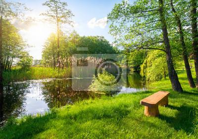 Wooden bench near river