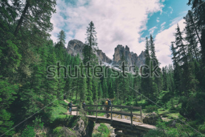 Sticker wooden bridge and saent waterfall on italian alps, Ambrizola mountains in Dolomites