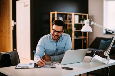 Sticker Young business man working at home with laptop and papers on desk